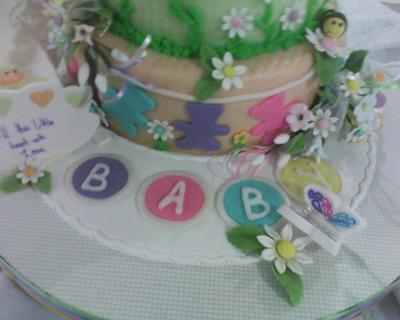 close up of daisy and butterfly baby cake
