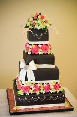 black wedding cake with gum paste flowers