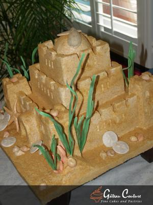 side view of sand castle wedding cake