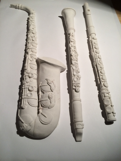 clay saxophone, clarinet and flute