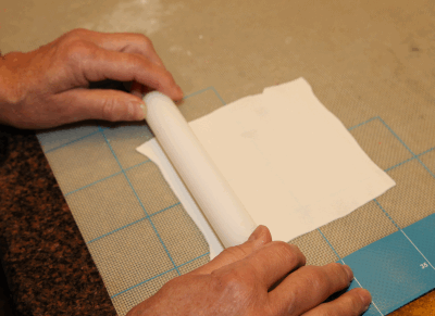 rolling out fondant square