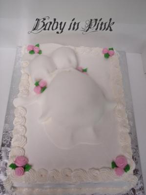 pretty in pink pregnant belly cake