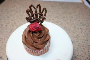 decorated raspberry cupcake