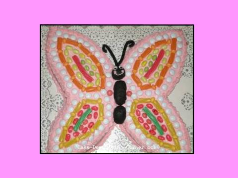 decorating a cake with candy, butterfly cake