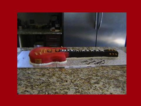 mathew's guitar cake in red