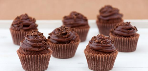 chocolate frosting on chocolate cupcakes